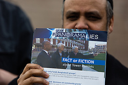 "© Licensed to London News Pictures. 05/04/2014. London, UK. A member of the Tower Hamlets First party holds a campaign leaflet titled ""Panorama Lies"" during a community walkabout in Stepney, East London on 5th April 2014 to canvas for the upcoming Mayoral election. Communities Secretary, Eric Pickles yesterday sent inspectors to start an audit of Tower Hamlets council and the Rahman administration following allegations of fraud and financial mismanagement, also reported by BBC's Panorama programme this week. Mayor Lutfur Rahman denies all allegations, which he calls ""Panorama lies"". Photo credit : Vickie Flores/LNP"