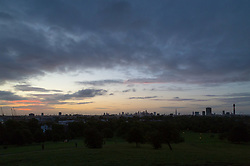 London, September 11 2017. The rising sun illuminates the clouds above the London skyline as a new day breaks over the city. © Paul Davey