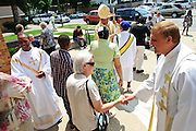 Chicago Auxiliary Bishop Joseph N. Perry (center in mitre cap) greets parishioners following a mass celebrating the centennial anniversary of SS. Peter and Paul Church on the city's south side on Sunday, July 7th. © 2013 Brian J. Morowczynski ViaPhotos<br /> <br /> For use in a single edition of Catholic New World Publications, Archdiocese of Chicago. Further use and/or distribution may be negotiated separately. <br /> <br /> Contact ViaPhotos at 708-602-0449 or email brian@viaphotos.com.