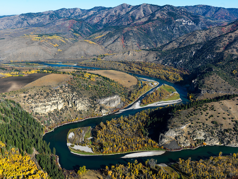 Aerial view of the South Fork of the Snake River looking down river toward the town of Ririe in Eastern Idaho with agriculture land patterns and autumn colors. Licensing and Open Edition Prints