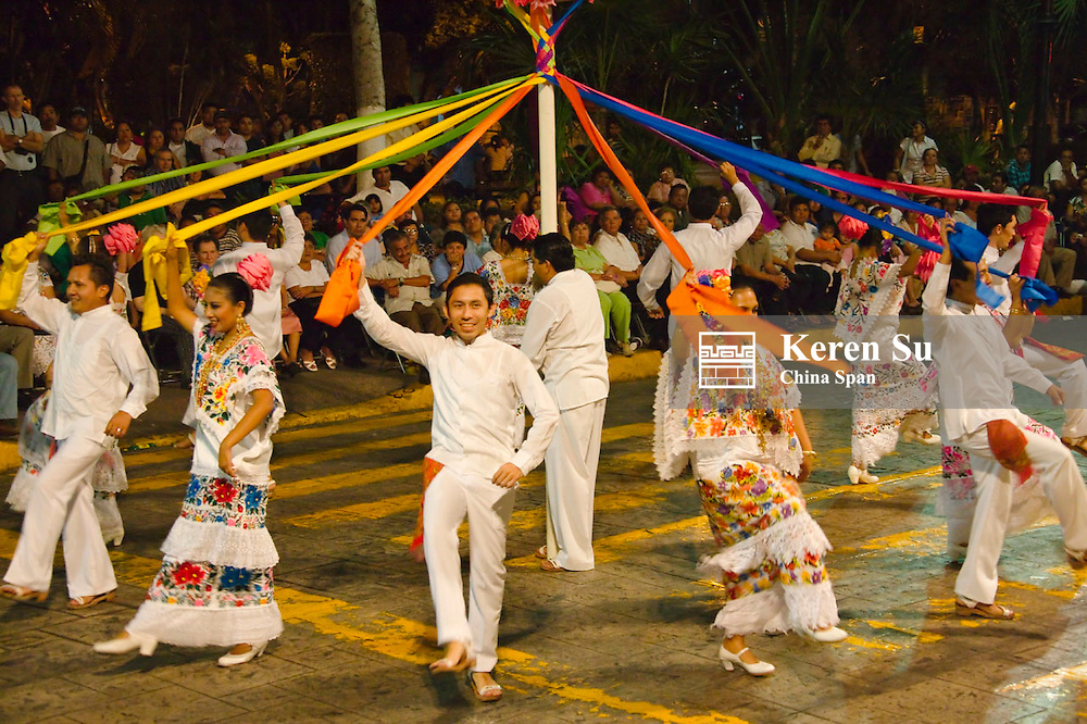 Mexican men and girls in traditional embroidered dress dancing, Merida, Yucatan State, Mexico