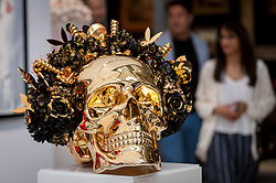 © Licensed to London News Pictures. 20/06/2018. LONDON, UK. A resin skull by Anna Kara at The Art & Antiques Fair Olympia which runs 20 to 27 June at Kensington Olympia.  Photo credit: Stephen Chung/LNP