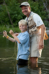 United States, Montana, Red Lodge, Lake Bill, father and son (age 9) fishing in pond.  MR