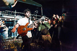 © Licensed to London News Pictures. 01/06/2014. Barcelona, Spain.   Foals performing live at Primavera Sound festival Day 4.   In this picture Yannis Philippakis dismounts the stage mid-set to walk greet the audience.  Foals are an English indie rock band  consisting of members Yannis Philippakis (lead vocals, lead guitar), Jack Bevan (drums, percussion), Jimmy Smith (rhythm guitar rhodes, synthesizer, backing vocals), Walter Gervers (bass, sampler, percussion, backing vocals),Edwin Congreave (keyboards, synthesizer).  Primavera Sound, or simply Primavera, is an annual music festival that takes place in Barcelona, Spain in late May/June within the Parc del Fòrum leisure site. Photo credit : Richard Isaac/LNP