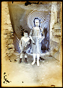 eroding glass plate photo with young adult mother and child