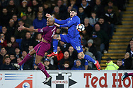 Callum Paterson of Cardiff city jumps for the ball with Vincent Kompany of Manchester city.The Emirates FA Cup, 4th round match, Cardiff city v Manchester City at the Cardiff City Stadium in Cardiff, South Wales on Sunday 28th January 2018.<br /> pic by Andrew Orchard, Andrew Orchard sports photography.