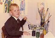 A child posing for school portrait