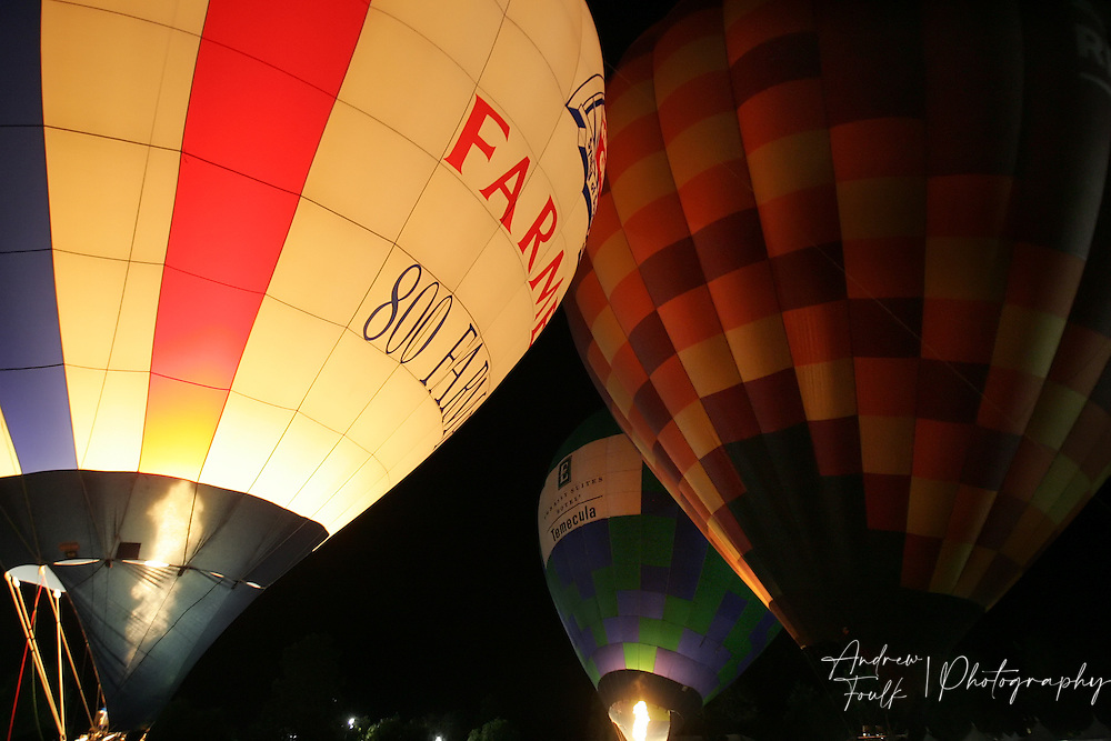 /Andrew Foulk/ For The Californian/.Hot air balloons illuminate the sky around Lake Skinner during the Balloon Glow part of the 26th annual Temecula Balloon and Wine festival.