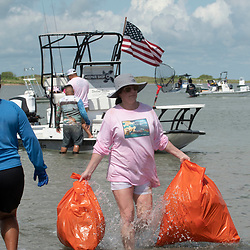 Dozens of South Texas residents in Willacy County participate in the annual Port Mansfield Beach Cleanup, an effort to clear trash from the Port Mansfield East Cut and jetties that washes in from the Gulf of Mexico. The cleanup generates tons of plastics and other waste from the pristine beaches and marshes of South Padre Island.