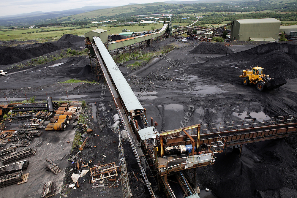 The Vale of Neath is visible from the Tower Colliery complex on Tuesday, June 19, 2007, in Hirwaun, Vale of Neath, South Wales. The time is ripe again for an unexpected revival of the coal industry in the Vale of Neath due to the increasing prize and diminishing reserves of oil and gas, the uncertainties of renewable energy sources, and the technological advancement in producing energy from coal while limiting emissions of pollutants, has created the basis for valuable investment opportunities and a possible alternative to the latest energy crisis. Unity Mine, in particular, has started a pioneering effort to revive the coal industry in the area, reopening after more than 8 years with the intent of exploiting the large resources still buried underground. Coal could be then answer to both, access to cheaper and paradoxically greener energy and a better and safer choice than nuclear energy as a major supply for the decades to come. It is estimated that coal reserves in Wales amount to over 250 million tonnes, or the equivalent of at least 50 years of energy supply, while the worldwide total coal could last for over 200 years as a viable resource compared to only a few decades of oil and natural gas.