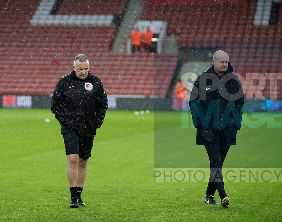 Referee Jonathan Moss (L) inspects the pitch during the Premier League match at Bramall Lane, Sheffield. Picture date: 9th February 2020. Picture credit should read: Simon Bellis/Sportimage