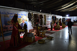 November 2, 2018 - Ankara, Turkey - A visitor looks at mannequins dressed in traditional costumes during famous Hatay Presentation Days in Ankara, Turkey on November 2, 2018. Hatay is one of 81 provinces in Turkey that is bordered by Syria to the south. With its assimilation of Arab and Turkic cultures, Hatay has been famous with its cuisine in Ottoman era and during the Turkish republic. Hatay had been also influenced geographically by many civilizations throughout history. (Credit Image: © Altan Gocher/NurPhoto via ZUMA Press)