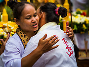 30 SEPTEMBER 2017 - BANGKOK, THAILAND: Women hug after praying before the Navratri parade in Bangkok. Navratri is a nine night (10 day) long Hindu celebration that marks the end of the monsoon and honors of the divine feminine Devi (Durga). The festival is celebrated differently in different parts of India, but the common theme is the battle and victory of Good over Evil based on a regionally famous epic or legend such as the Ramayana or the Devi Mahatmya. Navratri is celebrated throughout Southeast Asia in communities that have large Hindu population. Bangkok's celebration of Navratri was subdued this year because Thais are still mourning the death of Bhumibol Adulyadej, the Late King of Thailand, who died on October 13, 2016.      PHOTO BY JACK KURTZ
