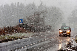 © Licensed to London News Pictures. 10/02/2020. Llanfihangel-nant-Melan, Powys, Wales, UK. Vehicles negotiate the dangerous road conditions on the A44 road near Llanfihangel-nant-Melan in Powys, during a heavy snow-fall this morning.  Photo credit: Graham M. Lawrence/LNP
