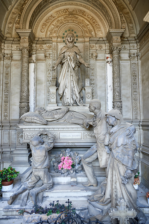 Picture and image of the stone sculpture of a grieving family around the death bed of the deceased. In a Borgeoise realistic style sculpted by GB Villa 1896. The Rivara Family Tomb, Section D no 15, the monumental tombs of the Staglieno Monumental Cemetery, Genoa, Italy .<br /> <br /> Visit our ITALY PHOTO COLLECTION for more   photos of Italy to download or buy as prints https://funkystock.photoshelter.com/gallery-collection/2b-Pictures-Images-of-Italy-Photos-of-Italian-Historic-Landmark-Sites/C0000qxA2zGFjd_k<br /> If you prefer to buy from our ALAMY PHOTO LIBRARY  Collection visit : https://www.alamy.com/portfolio/paul-williams-funkystock/camposanto-di-staglieno-cemetery-genoa.html