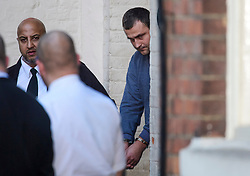 © Licensed to London News Pictures. FILE PICTURE 27/10/2017. Lorry driver RYSZARD MASIERAK (right) pictured being led to a prison van in handcuffs from Aylesbury Crown Court after a previous hearing. The trial of Ryszard Masierak and David Wagstaff is due to start at Reading Crown Court today (Thurs). The pair are accused of causing death by dangerous driving of six men and two women who were traveling in a minibus near Newport Pagnell on 26 August. Photo credit: Ben Cawthra/LNP