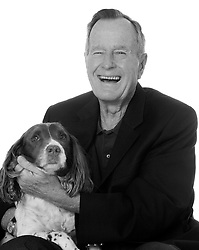 """April 10, 2005 - USA - quot;Top Dogs and Their Pets,"""" photography by David Woo and Richard Pruitt; Parapet Press (208 pages, 9.95) depicts a variety of famous people photographed with their animal companions, including former President George H.W. Bush. (David Woo/Dallas Morning News/TNS) (Credit Image: © Dallas Morning News/TNS/ZUMAPRESS.com)"""