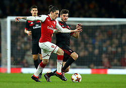 Hector Bellerin of Arsenal takes on Patrick Cutrone of AC Milan - Mandatory by-line: Robbie Stephenson/JMP - 15/03/2018 - FOOTBALL - Emirates Stadium - London, England - Arsenal v AC Milan - UEFA Europa League Round of 16, Second leg