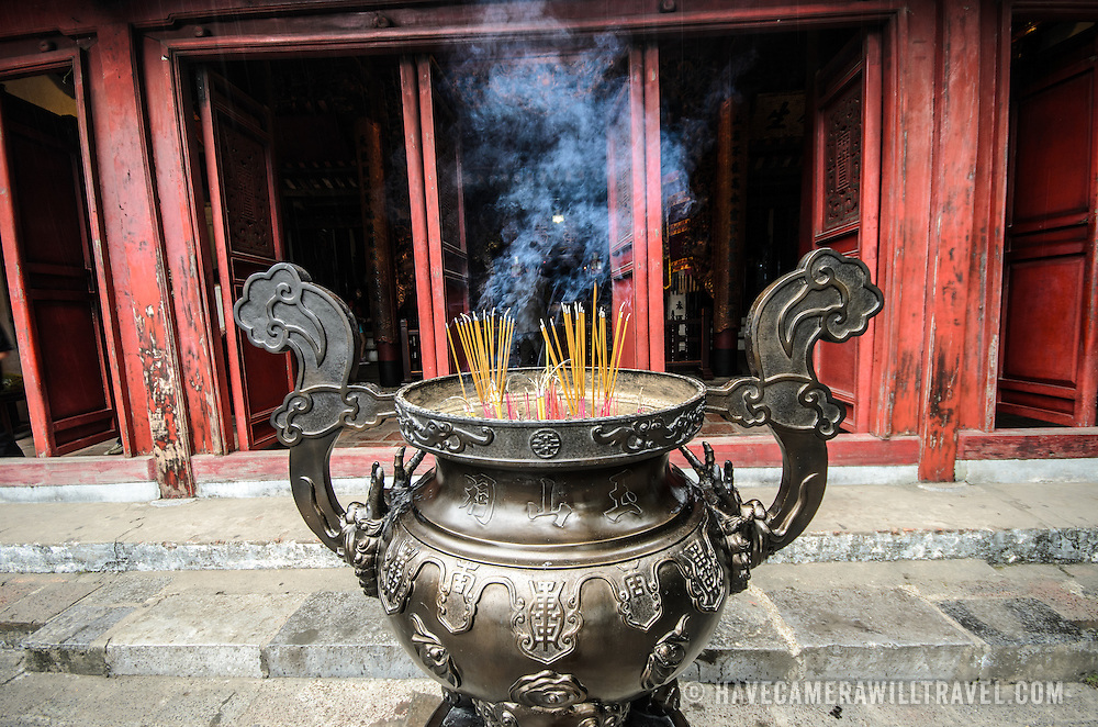 Incense urn at the Temple of the Jade Mountain (Ngoc Son Temple) on Hoan Kiem Lake in the heart of Hanoi's Old Quarter. The temple was established on the small Jade Island near the northern shore of the lake in the 18th century and is in honor of the 13-century military leader Tran Hung Dao.