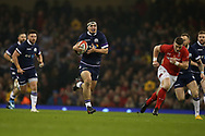 Stuart McInally of Scotland makes a break.Wales v Scotland, NatWest 6 nations 2018 championship match at the Principality Stadium in Cardiff , South Wales on Saturday 3rd February 2018.<br /> pic by Andrew Orchard, Andrew Orchard sports photography