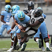 ORLANDO, FL - OCTOBER 24:  Defensive lineman Kenny Turnier #0 of the Central Florida Knights sacks quarterback Michael Pratt #7 of the Tulane Green Wave at Bounce House-FBC Mortgage Field on October 24, 2020 in Orlando, Florida. (Photo by Alex Menendez/Getty Images) *** Local Caption *** Kenny Turnier; Michael Pratt