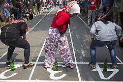 August 17, 2017 - Central Jakarta, Jakarta, Indonesia - Jakarta, Indonesia, 17 August 2017 : Foreign tourist having fun time during the Indonesia Independence day celebration at Jaksa Street. Jaksa street well known for foreign tourist to stay because of it cheap price for staying and the friendly welcome from the neigbourhood. (Credit Image: © Donal Husni via ZUMA Wire)