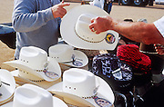 24 NOVEMBER 2001 - APACHE JUNCTION, ARIZONA, USA: A man buys a cowboy hat at the 2001 Superstition Mountain Stampede in Apache Junction, AZ, Nov 24, 2001. The rodeo is a fundraiser for charities in Apache Junction, which is about 40 miles from Phoenix. .PHOTO BY JACK KURTZ