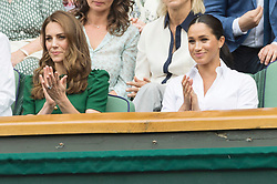 © Licensed to London News Pictures. 13/07/2019. London, UK. HRH The Duchess of Cambridge and HRH The Duchess of Sussex watches the ladies singles finals on centre court tennis on Day 12 of the Wimbledon Tennis Championships 2019 held at the All England Lawn Tennis and Croquet Club. Photo credit: Ray Tang/LNP