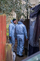 © Licensed to London News Pictures. 06/01/2020. London, UK. Police forensics teams enter a tent at a house in Nowell Road, Barnes South West London after police discovered human remains at the address on Friday 3rd January 2020. A 17 year old youth has now been charged with murder following the discovery at the address in Nowell Road. Photo credit: Alex Lentati/LNP