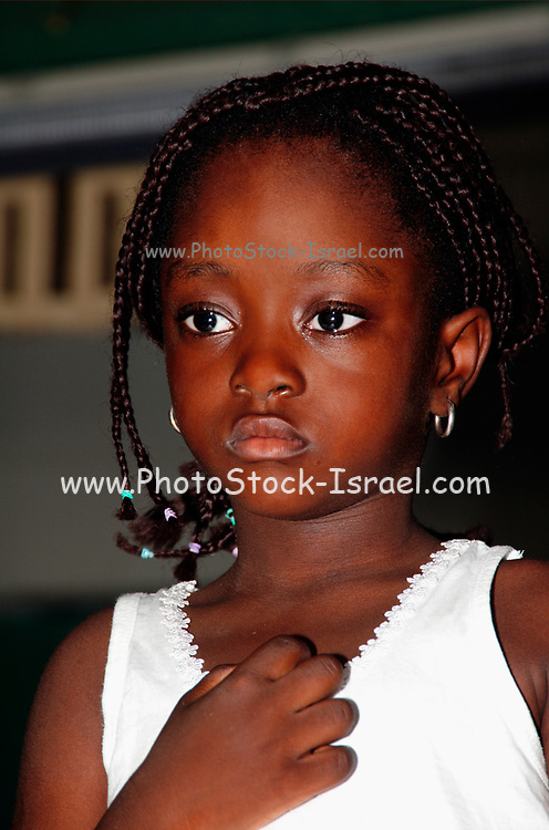 Portrait of a young African girl with beaded hair. Photographed in Tel Aviv, Israel