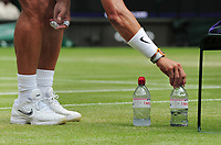 Tennis - 2019 Wimbledon Championships - Week Two, Monday (Day Seven)<br /> <br /> Men's Singles, Fourth Round: Joao Sousa (POR) vs. Rafa Nadal (ESP)<br /> <br /> Nadal lines up his water bottles before going on court, on Centre Court.<br /> <br /> COLORSPORT/ANDREW COWIE
