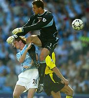 Photo Aidan Ellis.<br />Manchester City v Aston Villa.<br />FA Barclaycard Premiership.<br />14/09/2003.<br />City's Steve McManaman collides with Villa keeper Thomas Sorenson