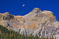 Moon over the San Juan Mountains as seen from the Million Dollar HWY on Red Mountain Pass.  Colorado.