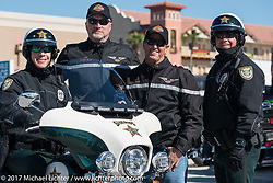 Harley-Davidson Regional Police And Fleet Sales Rep Rob Grimsley (3rd from left) with Daytona Beach motorcycle officers at Destination Daytona after the Harley-Davidson Women's Ride for MDA during Daytona Bike Week. Daytona Beach, FL. USA. Thursday March 16, 2017. Photography ©2017 Michael Lichter.