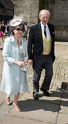 SIR IAN & LADY LOWSON at the wedding of Lady Natasha Rufus Isaacs to Rupert Finch held at St.John The Baptist Church, Cirencester, Gloucestershire, UK on 8th June 2013.