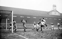 File photo dated 28-09-1961 of Crewe Alexandra goalkeeper Williamson (centre) raises his arms and gapes in anguish as he watches Tottenham Hotspurs' third goal scored by left half Mackay enter the back of the net during the fourth round FA cup-tie match at White Hart Lane, North London.