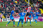 Lincoln City Forward Ollie Palmer heads the ball towards goal during the EFL Sky Bet League 2 match between Lincoln City and Grimsby Town FC at Sincil Bank, Lincoln, United Kingdom on 17 March 2018. Picture by Craig Zadoroznyj.