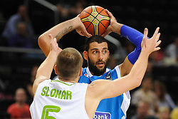 Uros Slokar of Slovenia vs Ioannis Bourousis of Greece during friendly match between National Teams of Slovenia and Greece before World Championship Spain 2014 on August 17, 2014 in Kaunas, Lithuania. Photo by Robertas Dackus / Sportida.com