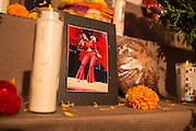 New York, NY, October 31, 2013. A woman's portrait is between a candle and a loaf of bread.