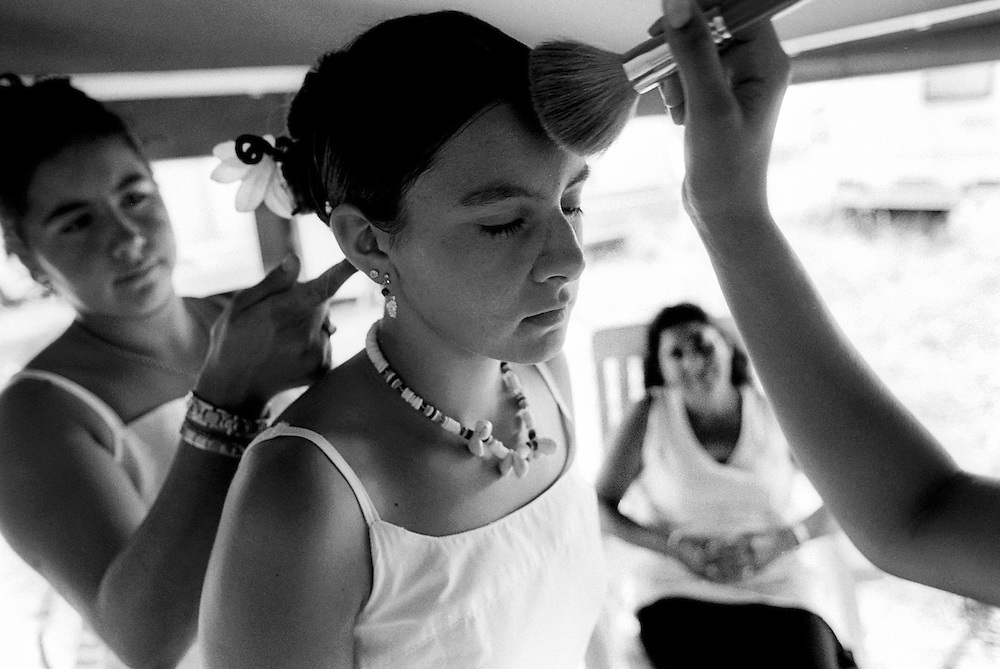 """Girl during the preparation before the baptism. France, Marville, August 2002 - 40,000 Gypsies from all over the Europe come together and pray in Marville, a little village in France. They encamped in a former air base of NATO during 1 week. """"Vie et Lumiere"""" is an International Evangelic Community. ©Jean-Michel Clajot / Cosmos"""