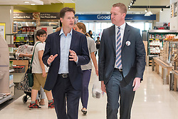 ***EMBARGO UNTIL 0001 FRIDAY 18th JULY 2014***© Licensed to London News Pictures. 16/07/2014. London, UK. NICK CLEGG talks with the store manager as he tours the store.  Deputy Prime Minister and Leader of the Liberal Democrats Nick Clegg visits Tesco in Kensington to meet staff along with Jo Swinson. The Liberal Democrats will say in their 2015 manifesto that they will require large companies to publish the average salary of their male and female employees, increasing public pressure for equal pay. Tesco are one of the companies that currently publish this information voluntarily under the Government's Think, Act, Report scheme.. Photo credit : Stephen Simpson/LNP