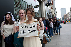 © licensed to London News Pictures. London, UK 11/03/2012. A Twilight film fan is posing with sign for Robert Pattinson as The Twilight Saga fans are attempting to set a Guinness World Record for the longest chain of brides as the DVD release of The Twilight Saga: Twilight Breaking Dawn - Part 1takes place at HMV Oxford Street in London. Photo credit: Tolga Akmen/LNP