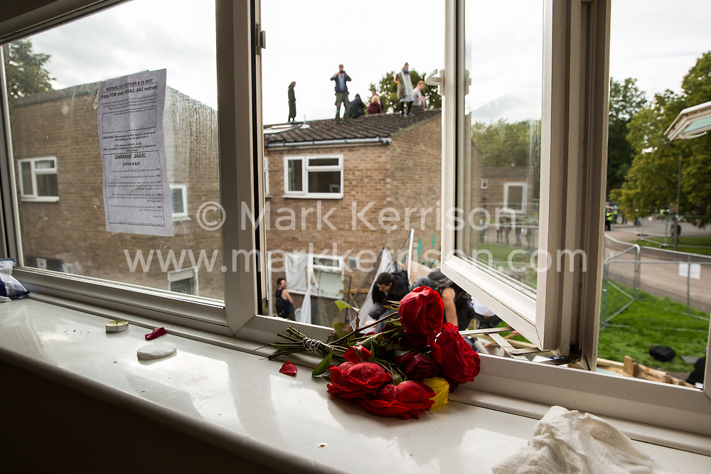 A view of housing activists occupying a rooftop on the Sweets Way housing estate close to the home of its last surviving resident, Mostafa Aliverdipour, on 23rd September 2015 in London, United Kingdom. A group of housing activists calling for better social housing provision in London had occupied some of the properties on the 142-home estate in Whetstone, in some cases refurbishing properties intentionally destroyed by the legal owners following eviction of the original residents, in order to try to prevent or delay the eviction of Mr Aliverdipour and the planned demolition and redevelopment of the entire estate by Barnet Council and Annington Property Ltd.