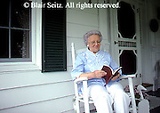Active Aging Senior Citizens, Retired, Activities, Grandmother Reads on Home Porch, Aging at Home, Rocking Chair