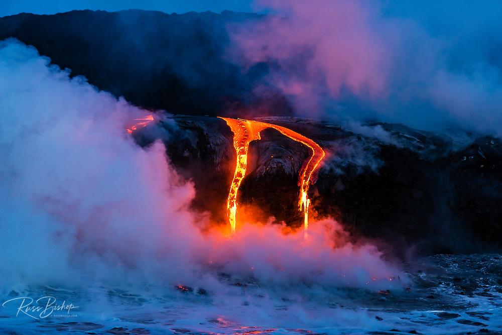 Lava flow entering the ocean at dawn, Hawaii Volcanoes National Park, The Big Island, Hawaii USA