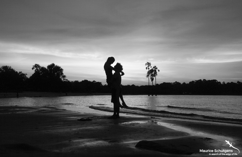 A couple focuses on each other in the wilderness of Canaima National Park, Venezuela.