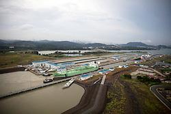 Green oil tanker navigating the Miraflores Locks at the Panama Canal.