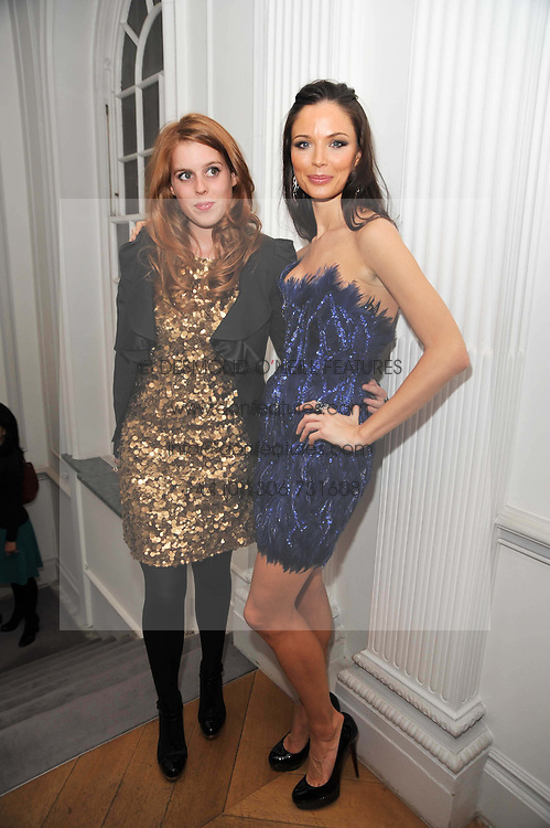 Left to right, PRINCESS BEATRICE OF YORK and GEORGINA CHAPMAN at a party to launch the Georgina Chapman collection for Garrard held at Garrard, Albermarle Street, London on 4th November 2009.
