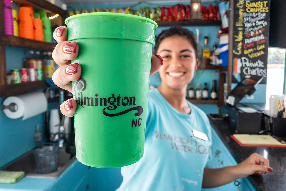 Toni serves mixed drinks during the guided tour on a pontoon boat with Wilmington Water Tours in Wilmington, North Carolina on Monday, August 9, 2021. Copyright 2021 Jason Barnette