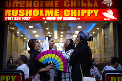 © Licensed to London News Pictures. 20/07/2021. Manchester, UK. KHADZ MUSHY , MAKHADIJA SAYID, MUSHTAQ HASSAN and ARIJ MOHAMED (all from Moss Side) outside Rusholme Chippy . Muslims celebrate Eid al-Adha in Rusholme in Manchester. The festival marks the Islamic tale of the prophet Ibrahim , who offered his son as a sacrifice to Allah . Photo credit: Joel Goodman/LNP